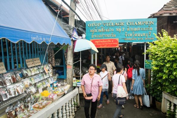 Locals visiting weekend market in Koh Kret